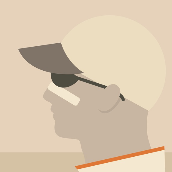 Profile of man wearing baseball cap and sunglasses