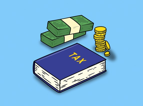 Money and tax book on blue background