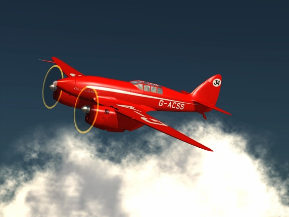 Red airplane in sky
