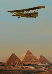 Airplane in sky over pyramids