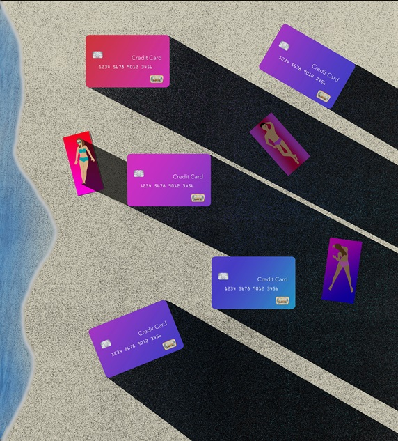 People lying on beach surrounded with big credit cards