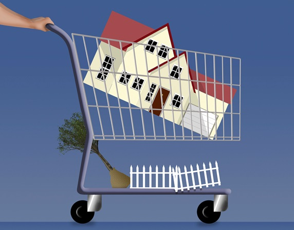 Man pushing new home in shopping trolley