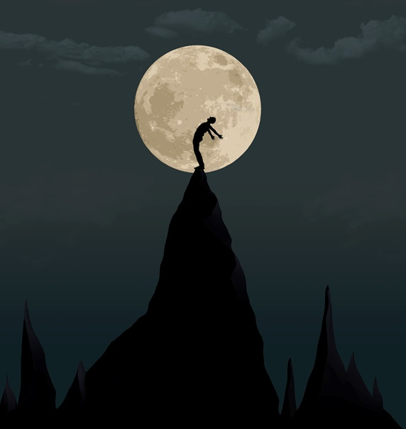 Silhouette of person on top of mountain against moon ay night