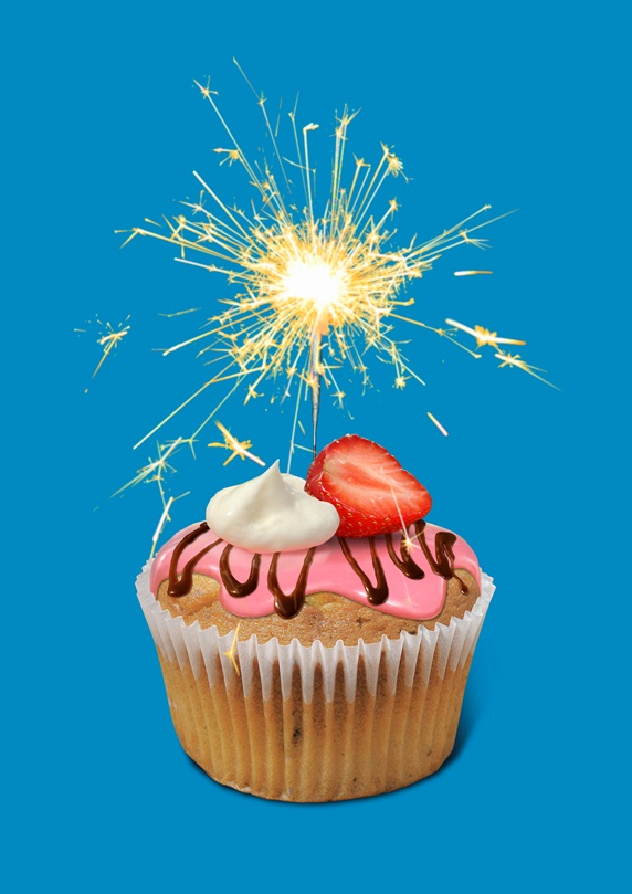 Sparkler burning on top of cupcake