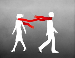 Man and women in scarf walking on windy day