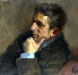 Portrait of man with hand on chin