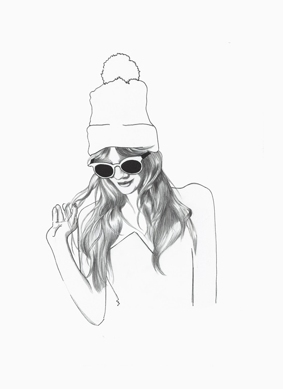 Fashionable young woman wearing sunglasses and bobble hat
