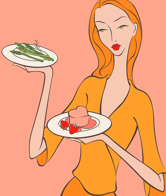 Beautiful woman bringing asparagus and heart-shape dessert
