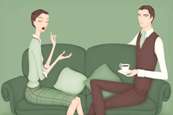 Portrait of elegant couple sitting on sofa