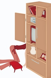 Mid-section of woman kneeling behind drawer