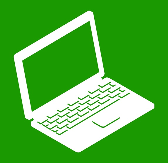 Laptop on green background