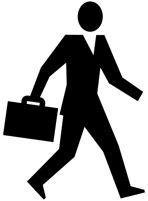 Silhouette of man walking with suitcase