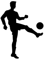 Silhouette of man kicking ball