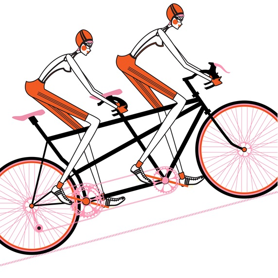 Two women cycling tandem bicycle